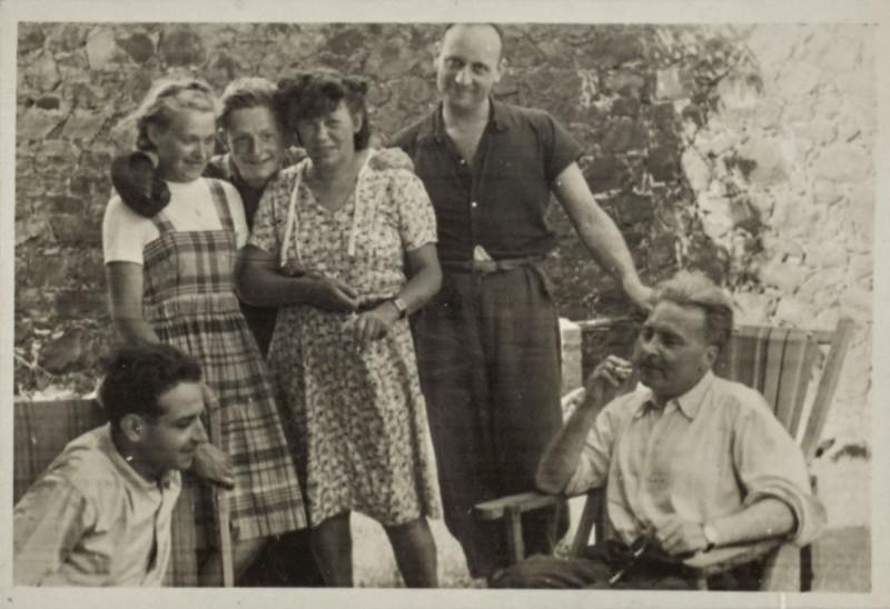 A group photo in Lazaret, April 1941. Seated on the left: Jacques Rémy; center: Germaine Krull; on the right, seated in deck chair: Victor Serge. Photo likely taken by Vlady Serge.