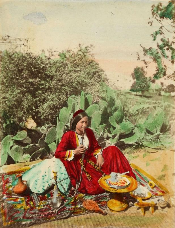Charles Lallemand, Ludovico Hart, Christian woman from Zouk Mikael (northern Lebanon) smoking a hookah and making coffee on a terrace, circa 1863-1865. Fouad Debbas Collection/ Sursock Museum.